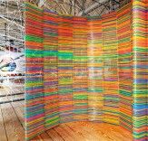 Two Portuguese designers, tired of watching clothes hangers tossed aside after a brief life on the rack, decided to reclaim them as functional art. Diogo Agular and Teresa Otta of LIKEarchitects rescued 2,000 colorful IKEA children's hangers that were destined for the landfill and designed a technicolor Chromatic Screen for the 2012 Oporto Show, the most prestigious event for interior design and architecture on the Iberian Peninsula.
