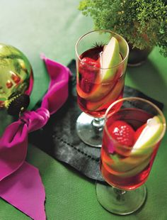 Santa Sangria      2 large green apples, cored and cut into thin slices     2 cups frozen raspberries     6 cups rosé     1 cup pomegranate juice  Preparation  Put fruit and ice in wine glasses. Combine rosé and juice in a pitcher; pour into glasses.  Read More http://www.epicurious.com/recipes/food/views/Santa-Sangria-362712#ixzz2m53QgEQ8