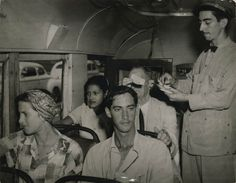 Bus riders show their tickets in Havana, 1954.