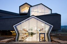 VitraHaus building, a series of stacked pitched-roof boxed, designed by Herzog & de Meuron