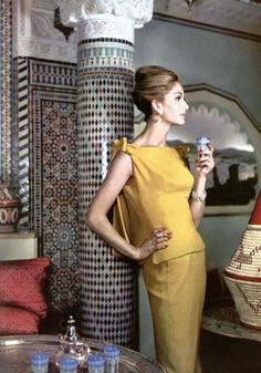 Model in yellow crêpe two-piece, top is slit on the sides held with bows on the shoulders dipping in back by Jean Dessès, photo by Pottier, 1962