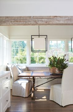 breakfast nook (Add the exposed beam --create step up? love light fixture and calming colors although in the long run would def not be kid friendly---white = disaster
