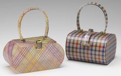 a pair of laminated Lucite handbags by Wilardy (style #876 on the left, #750 on the right)