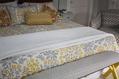 Gray and Yellow bedding is Dwell Studio from Target  If you follow the link you will find out how to take a picnic bench and turn it into this end of bed bench so cool