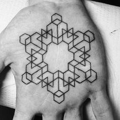 Geometric mandala on a palm.