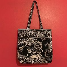 Vera Bradley Tote Black and white paisley print and houndstooth interior. Three interior slip pockets. Used just a couple of times but it looks brand new, no wear  and tear! Feel free to ask any questions! Vera Bradley Bags Totes