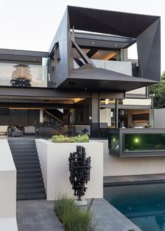 This modern house shows its dynamic, spectacular and unique sculptural design. Bold look and brutal lightness of metal and glass combinations define this contemporary house design envisioned by Nico van der Meulen Architects and M Square Lifestyle Design. Huge columns and inclined beams, large glass