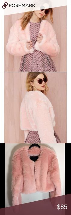 Angel Baby Faux Fur Coat pink 'Tis the season to think pink. The Angel Baby Jacket has a pink faux fur exterior and features cropped length, open front, and full lining. Rock it with black high-waisted skinnies and moto boots, or over a vintage jumpsuit with a wild crossbody. By Nasty Gal.  *Acrylic/Polyester  *Runs true to size  *Model is wearing smallest size available  *Dry Clean  *Imported Nasty Gal Jackets & Coats