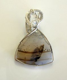 Do you see the butterfly?  Butterfly Montana Moss Agate Wire Wrapped by desertshinejewelry, $90.00