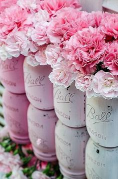 Pink mason jars filled with pink flowers! Perfect decorations or centerpieces for your pink party. by wanda