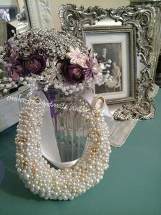Pearly beads , each one handsewn in this beautiful Brides Good luck Horseshoe.