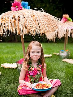Luau Party Umbrellas - Kids can hide out from the sun under easy-to-make grass huts when it's time to eat at the luau. Place a few around the yard and use grass placemats as seats.