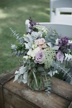 Pale purple and silver flower arrangement for rustic wedding ceremony   LoveHer Photography   See more: http://theweddingplaybook.com/rustic-lavender-winery-wedding/