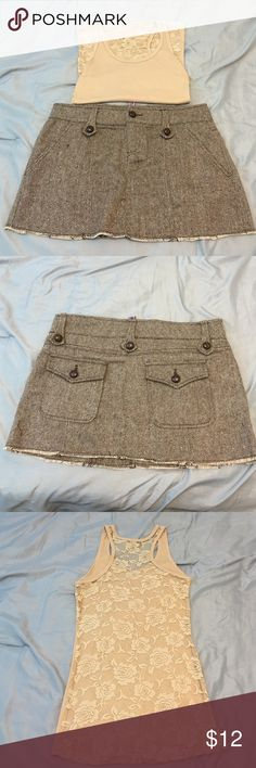 Cute Skirt with Free Matching tank Cute Skirt With free Tank.  Skirt is dark brown and creamy tan. Tank is tan.  Tag was removed on the tank because you could see it through the lace.  Tank is a small. Dollhouse Skirts Mini