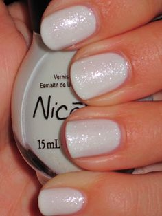 OPI Nicole ~ It's All About The Glam  -- ' (4 coats)- This is no ordinary white. It's a milky white loaded with shimmer that flashes pink and blue and you can see bits of teal in it. ' by nailstah #whitenails #nailsphotography #milkywhite