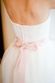 vera wang bride. love the pale pink bow.