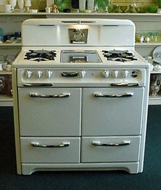 Grandma Pittman had a stove like this but it only had 1 oven door that was wide.