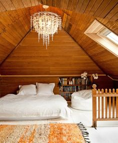 Dress up an attic with a chandelier and a mini library.