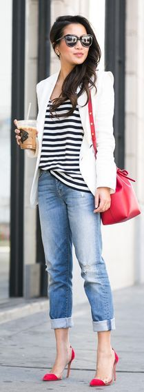 Spring / Summer - chic street style - distressed denim cropped skinnies + red handbag + red stilettos + black and white striped t-shirt + white blazer + black sunglasses