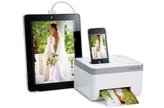 This iPhone Photo Printer http://everymomneeds.com/iphone-photo-printer/