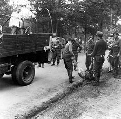 Bergen Belsen, Germany, Germans carrying corpses to burial, after the liberation, April 1945. Germans were forced to bury bodies found littering the camps. They knew what was happening and did nothing. Making them bury the murdered is a fitting start