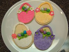Easter cookies - Sugar cookies covered with MMF. Grass is royal icing and bought  chocolate eggs.