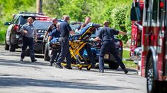 In this May 31, 2014, file photo, rescue workers take a 12-year-old stabbing victim to an ambulance in Waukesha, Wis.
