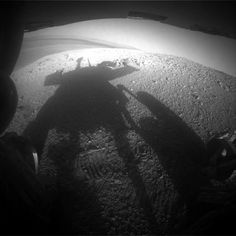 """Shadow Portrait of NASA Rover Opportunity on Martian Slope (2014-03-20). The rover's silhouette was caught by its rear hazard avoidance camera. It's looking eastward shortly before sunset on the western rim of Endeavour Crater. The scene includes a glimpse into the distance across the 14-mile-wide (22-kilometer-wide) crater. (Image Credit: NASA/JPL-Caltech) Mona Evans, """"Good-bye Spirit"""" http://www.bellaonline.com/articles/art48902.asp"""