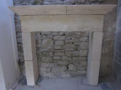 Large and understated French warm limestone fireplace from the Charente region. Early 19th Century. For sale on SalvoWEB from Wharton Antiques in Somerset [Salvo code #salvo #discoverantiques