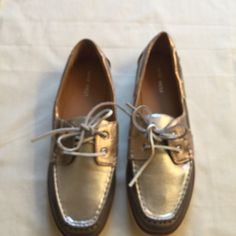 NWOT Nine West boat shoes. These new, never worn boat shoes in gold and silver metallic leather print or great for when you want to just be casual with a little pop. Nine West Shoes