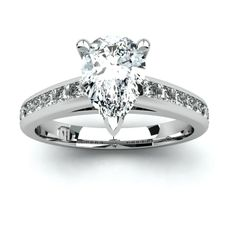 PEAR shaped white diamond engagement ring by Diamonds International.  #diamondsinternational #love #diamond #diamondengagementring #marryme #diamondring #ring #peardiamond