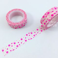 Neon Pink Polka Dots Washi Tape. This tape is perfect for all paper projects! Use as a border to make unique scrapbook pages! This tape has the perfect amount of adhesive; letting the tape hold firm w