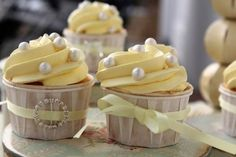 cupcakes decorated with pearls and ribbon
