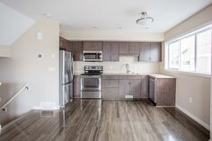 Life in Harbour Landing is a new townhome community located in Regina's beautiful Harbour Landing Townhouse, Landing, Kitchen Cabinets, Life, Home Decor, Decoration Home, Terraced House, Room Decor, Cabinets