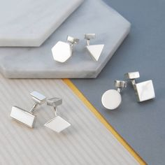 These men's mismatched sterling silver cufflinks come in array of quirky geometric shapes, adding a fashionable and innovative edge to any suit.  Ideal for super-stylish gents! #Otisjaxon #Jewellery