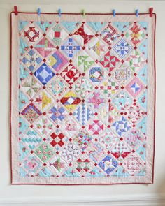 """Farmer's Wife quilt by Helen Philipps: """"I finished quilting round each shape in each block, and then I used a leaf and vine stencil to draw a simple quilting pattern in the plain pink border"""""""