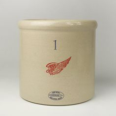 A tradition since the mid-1800's, Red Wing stoneware is still made along the banks of the Mississippi River in Minnesota.  Handmade, sturdy, and functional, the stoneware has a characteristic soft grey color and clear salt glaze, created by introducing rock salt into the hot kiln during the firing process.  The red wing logo is essentially unchanged over 150 years.