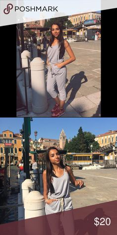 Grey Jumpsuit Bought in Venice, Italy. I am modeling it in Venice a year ago. It is super cute but its time for some new clothes! Doing my fall cleaning and have worn this just once! I cut tags because it itched lol but i am an xs but this fits up to small in my opinion.  BUNDLE AND SAVE. :) happy shopping. brand used just for exposure on posh Pants Jumpsuits & Rompers