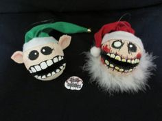 Need Zombie Xmas Novelty Gifts? Who doesn't? Anyway: dead xmas buddies     santa zombie and screamin elf by deadbuddies, $22.00