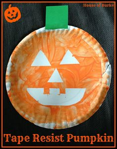 Tape Resist Paper Plate Pumpkin Craft with a tie in to the book This is NOT a Pumpkin! :) - House of Burke