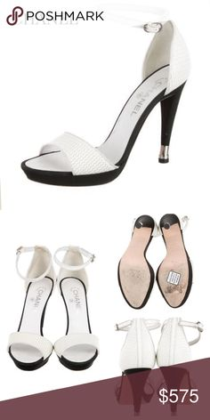"""CHANEL PLATFORM WHITE SANDALS Chanel white textured patent leather platform sandals w silver-tone hardware, leather trim, interlocking CC at heel tap, grosgrain heels & buckle closure at ankles. Round Toe. Color: White. Shoe Size: 8.5. Approx Measurements: Heels 4.5"""", Platforms 0.5"""". Condition: Faint scuffs at soles. SOLD OUT! CHANEL Shoes"""