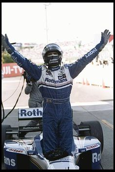 Damon Hill of the Williams Renault team celebrates after winning the world championship during the Japanese grand prix at Suzuka Japan Mandatory. Le Mans, Formula 1 Gp, Damon Hill, Japanese Grand Prix, Williams F1, F1 Drivers, F1 Racing, Car And Driver, World Championship