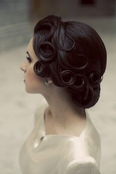 1940's hairstyle, pincurls & backcombing. I would bet that sold a lot of hair spray. that could have been when hair spray was first invented.