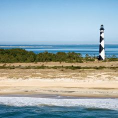North Carolina's Outer Banks. The endlessly curving roads of the Outer Banks make it a fun ride for those with a strong stomach. Small beach towns dot the landscape with dunes and long beaches in between. Create a circuit by taking U.S. highways 17, 158, and 64. | Coastalliving.com