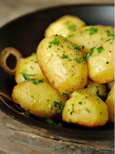 Potatoes baked in Chicken Broth, Garlic and Butter, SO GOOD! They get crispy on the bottom but stay fluffy inside. Chocked full of flavor. *...