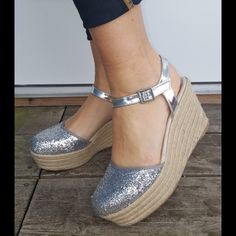 """GLAM"" silver espadrilles Transport yourself to a tropical island getaway in these glam espadrille wedges! ✨Features a metallic glittered toe ✨Espadrille platform wedge heel and side buckled ankle strap  ✨Approximate heel height 3 1/2 inches ✨Approximate platform height 2 inches CupofTea Shoes Espadrilles"