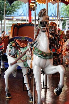Carousel Horse- Hershey Park has an all wood carousel with moving and stationary horses that spins counter-clockwise. Music is provided by a Wurlitzer model 153 military band organ.