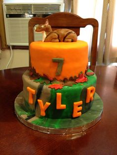 Camo birthday cake with fondant deer topper