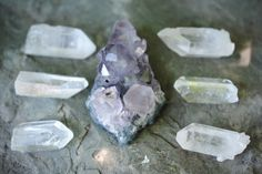 starseedmind:  Small amethyst crystal cluster, with 6 quartz crystal points help to amplify the amethysts energy :)