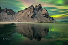Vestrahorn Mountain - The Beautiful colours of the northern lights over vestrahorn mountain in Iceland
